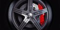 Car wheel with red breaks on black background. - PhotoDune Item for Sale