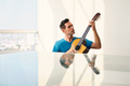 Young Musician Playing Guitar At Home - PhotoDune Item for Sale