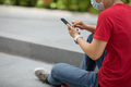 Asian woman sit on skateboard using smartphone in modern city - PhotoDune Item for Sale