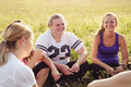 Group of female friends chatting in a spring field - PhotoDune Item for Sale