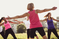 Group of young female friends exercising in a park - PhotoDune Item for Sale
