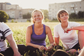 Smiling young women sitting chatting to friends - PhotoDune Item for Sale