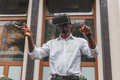 African businessman use virtual reality glasses on the street. VR headset - PhotoDune Item for Sale