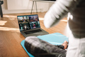 Woman conducting virtual fitness classes over video conference - PhotoDune Item for Sale