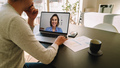 Woman teleconferencing with female colleague on laptop - PhotoDune Item for Sale