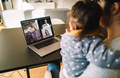 Woman teleconferencing with family on laptop - PhotoDune Item for Sale