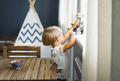 Cute blonde boy in white t-shirt with cat at bright room at the home - PhotoDune Item for Sale