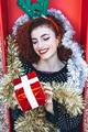 Beautiful redhead young woman with christmas stuff - PhotoDune Item for Sale