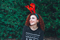 Young happy redhead woman near a christmas tree on holidays - PhotoDune Item for Sale