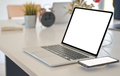 Close-up shot of Laptop and smartphone mockup a blank screen on a desk. - PhotoDune Item for Sale