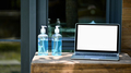 close - up shot of Mockup laptop blank screen with alcohol gel on a wooden table. - PhotoDune Item for Sale