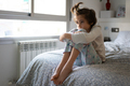 Nine-year-old girl sitting in bed bored by confinement - PhotoDune Item for Sale