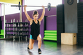 Athletic woman in gym lifting weights at the gym - PhotoDune Item for Sale