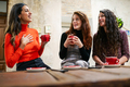 Group of three happy friends drinking coffee in a cafe bar - PhotoDune Item for Sale