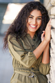 Happy Arab Woman with curly hair outdoors - PhotoDune Item for Sale