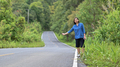 Tourist woman standing hitchhiker for travel. - PhotoDune Item for Sale