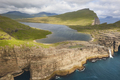 Faroe islands dramatic coastline in Vagar from helicopter. Leitisvatn lake - PhotoDune Item for Sale