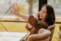 Charming brunette woman with long curly hair sitting in cafe with mobile phone - PhotoDune Item for Sale