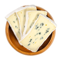 Slices of soft cheese with white and blue mold in wooden bowl - PhotoDune Item for Sale