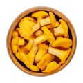 Fresh chanterelles, Cantharellus, edible mushrooms in a wooden bowl - PhotoDune Item for Sale