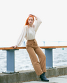Full length redhead female in casual clothes posing on pier - PhotoDune Item for Sale