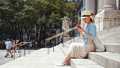 Attractive woman with phone on the steps of a building - PhotoDune Item for Sale