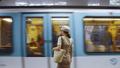 Young woman waiting for a train at the station in Paris - PhotoDune Item for Sale