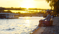 Young girl by the river at sunset in Paris - PhotoDune Item for Sale