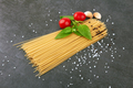spaghetti on a stone black background with basil - PhotoDune Item for Sale