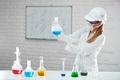 Young woman analyses chemical liquids in the tubes - PhotoDune Item for Sale