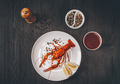 Food concept. Boiled big red fresh crawfish in white plate with lemon slices - PhotoDune Item for Sale