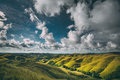 Green meadows on cloudy sky background. Sumba - PhotoDune Item for Sale