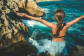 Girl with raised hands enjoy ocean view - PhotoDune Item for Sale
