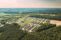 Aerial Bird's-eye View Of Building Of Pig Farm Located In Wood Area In Sunny Day - PhotoDune Item for Sale
