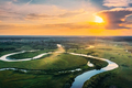 Aerial View. Beautiful Sunset Sun Sunshine Above Green Forest, Meadow And River Landscape In Sunny - PhotoDune Item for Sale