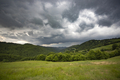 Storm clouds above meadow with green grass - PhotoDune Item for Sale