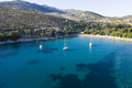 Sail boats in turquoise water in Thassos, Greece - PhotoDune Item for Sale