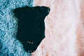 Black baby body agains a soft two colors background - PhotoDune Item for Sale