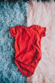 Red baby body against soft background - PhotoDune Item for Sale