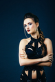 white girl modell on a dark background in a dress made of cut stripes - PhotoDune Item for Sale