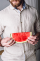 Bearded man in shirt holds in hands slice of watermelon - PhotoDune Item for Sale