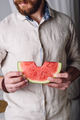 Bearded man in shirt with bitten off piece of watermelon - PhotoDune Item for Sale