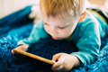Little Blond Boy Playing Games On Phone - PhotoDune Item for Sale