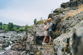 Happy young couple travelers in casual outfits on mountain river background - PhotoDune Item for Sale