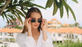 Beautiful stylish blond girl wearing sunglasses on terrace with amazing view from the villa on hills - PhotoDune Item for Sale