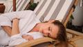 Gorgeous girl in homewear sleeping on deck chair in courtyard of tropical villa - PhotoDune Item for Sale