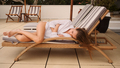 Beautiful stylish girl in white shirt dreamily lying resting on deck chair on modern villa - PhotoDune Item for Sale