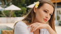 Gorgeous girl with tropical flower in hair sensually posing outdoor on villa on paradise island - PhotoDune Item for Sale