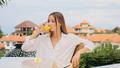 Beautiful girl in sleepwear drinking orange juice having breakfast on terrace with amazing view - PhotoDune Item for Sale