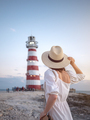 Young girl at the lighthouse - PhotoDune Item for Sale